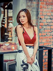Hintergrundbilder Asiaten Hand Rock Dekolleté Braunhaarige Niedlich junge Frauen