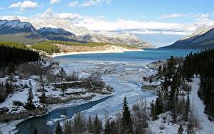 Bilder Kanada Winter Gebirge Flusse See Landschaftsfotografie Schnee Bäume River Klein, Lake Abraham, Western Alberta
