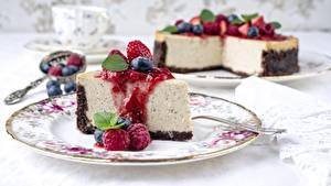 Bilder Himbeeren Stück Teller Cheesecake das Essen