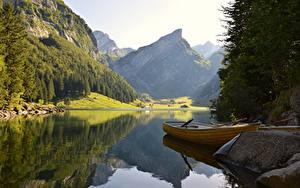 Fotos Steine See Boot Gebirge Wälder Landschaftsfotografie Felsen