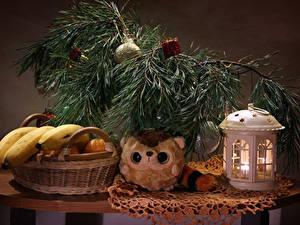 Bilder Neujahr Stillleben Bananen Kerzen Ast Weidenkorb Lebensmittel