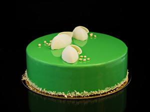 Fotos Süßware Torte Schwarzer Hintergrund Design Gelb grüne Lebensmittel