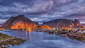 Image Norway Lofoten Mountains Houses Pier Evening Bay Reine Cities