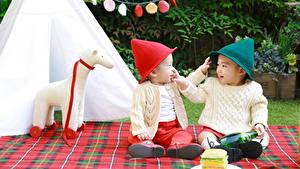 Pictures Asiatic 2 Winter hat Sweater Boys Sitting Children