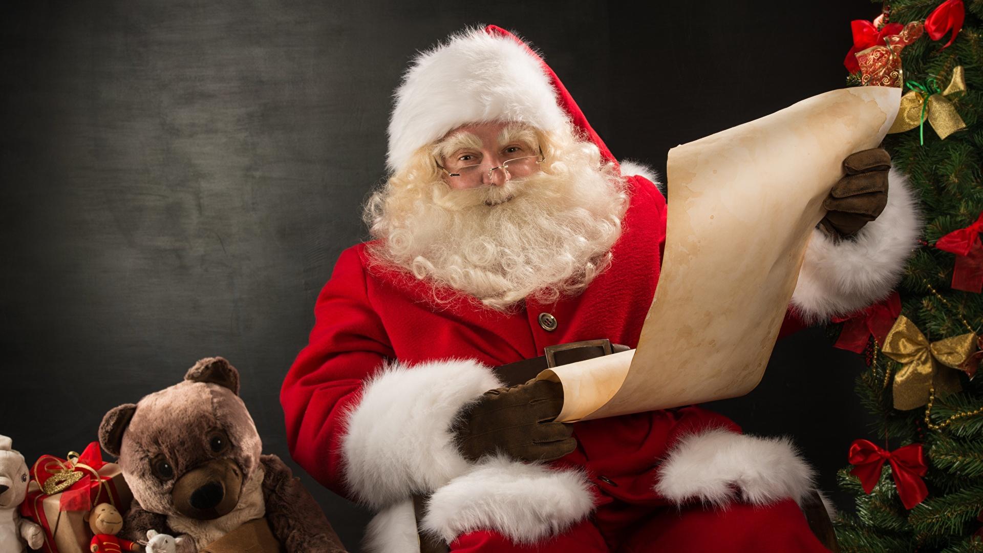 Bilder Barthaar Mütze Weihnachtsmann Teddy Geschenke Brille Sitzend 1920x1080 Teddybär Knuddelbär