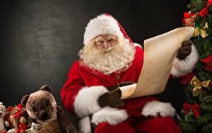 Bilder Teddy Weihnachtsmann Geschenke Mütze Brille Bärtiger Sitzend