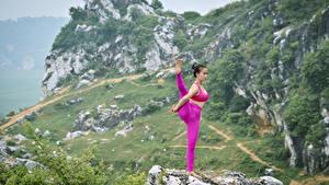 Bilder Asiatische Yoga Körperliche Aktivität Dehnübung junge frau
