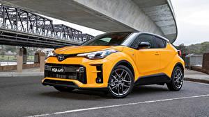 Bilder Toyota Crossover Gelb Metallisch Hybrid Autos C-HR Hybrid GR Sport, AU-spec, 2020 automobil