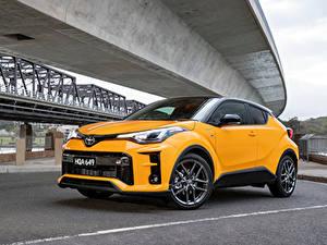 Bilder Toyota Crossover Gelb Metallisch Hybrid Autos C-HR Hybrid GR Sport, AU-spec, 2020