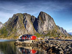 Bilder Norwegen Lofoten Küste Gebäude Felsen Bucht Natur