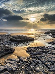 Bilder Vereinigtes Königreich Sonnenaufgänge und Sonnenuntergänge Küste Himmel Landschaftsfotografie Wolke Wales Dunraven Bay Natur