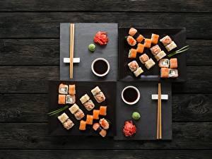 Bilder Sushi Fische - Lebensmittel Essstäbchen Sojasauce Bretter Lebensmittel