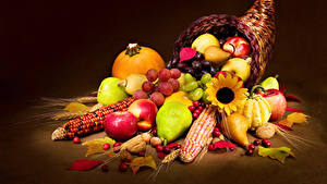 Picture Fruit Corn Pumpkin Apples Pears Nuts Grapes Colored background Wicker basket
