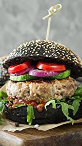 Fotos Fast food Hamburger Brötchen Gemüse Ketchup Schneidebrett