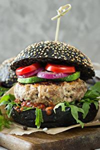 Fotos Fast food Hamburger Brötchen Gemüse Ketchup Schneidebrett Lebensmittel