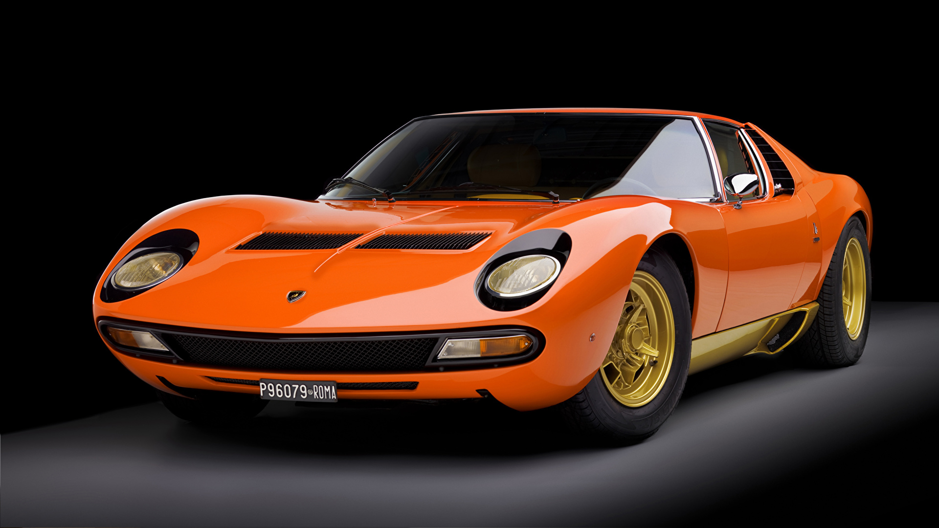 Fotos Lamborghini 1973 Miura P400 SV Worldwide Bertone antik Orange automobil Metallisch Schwarzer Hintergrund 1920x1080 Retro auto Autos
