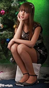 Image New year Balls Brown haired Staring Sit Legs Girls