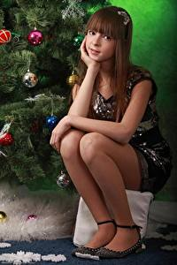Image New year Balls Brown haired Staring Sitting Legs Girls