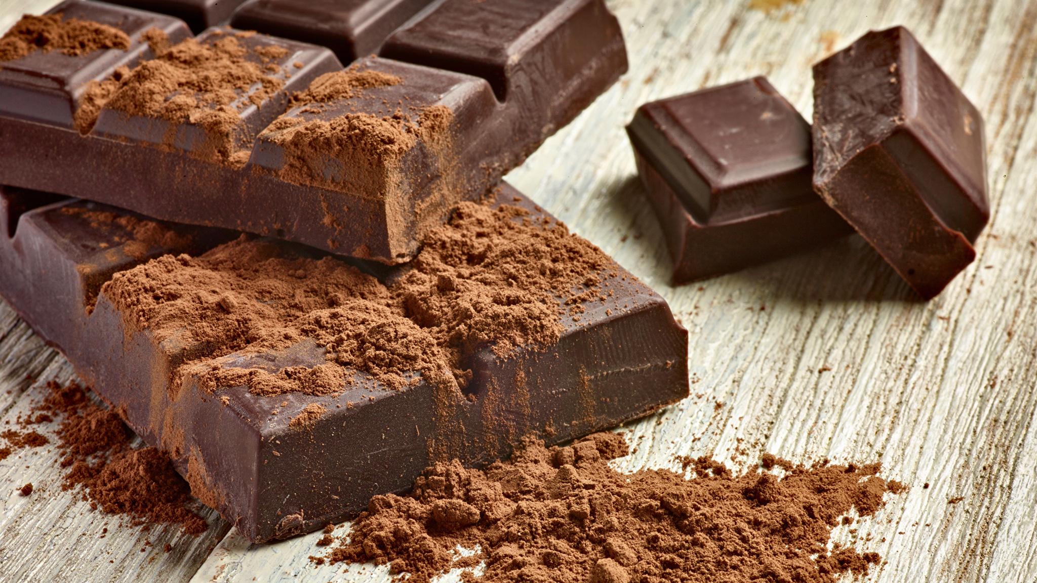 Bilder von Lebensmittel Schokolade Bretter Kakaopulver Süßware Schokoladentafel 2048x1152 Süßigkeiten