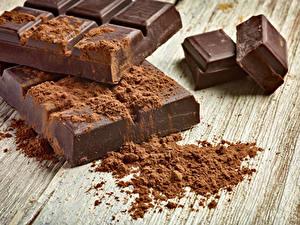 Fotos Süßware Schokolade Bretter Kakaopulver Lebensmittel