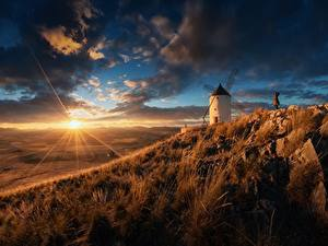 Image Sunrises and sunsets Sky Meadow Spain Rays of light Sun Windmills