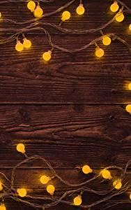 Fotos Neujahr Lichterkette Bretter Vorlage Grußkarte
