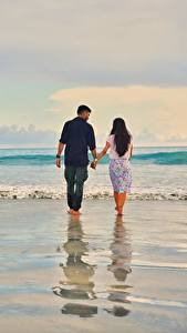 Pictures Sea Waves Man Lovers Water Beaches Two Walking On a date Nature
