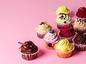 Fotos Törtchen Farbigen hintergrund Design Mehrfarbige Lebensmittel