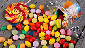 Hintergrundbilder Süßigkeiten Bonbon Dauerlutscher Bretter Weckglas das Essen