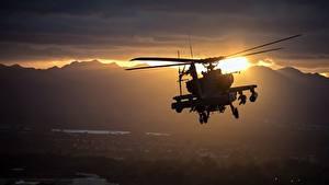 Bilder Hubschrauber Sonnenaufgänge und Sonnenuntergänge AH-64 Apache Flug US Luftfahrt