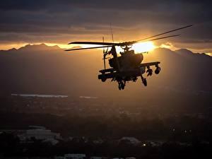 Bilder Hubschrauber Sonnenaufgänge und Sonnenuntergänge AH-64 Apache Flug US