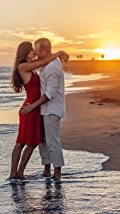 Images Sunrises and sunsets Lovers Men Beach 2 Hug Kiss Girls