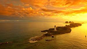 Fotos Sonnenaufgänge und Sonnenuntergänge Insel Leuchtturm Himmel Nassau Bahamas Natur