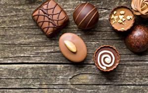 Hintergrundbilder Süßigkeiten Bonbon Schokolade Bretter Lebensmittel