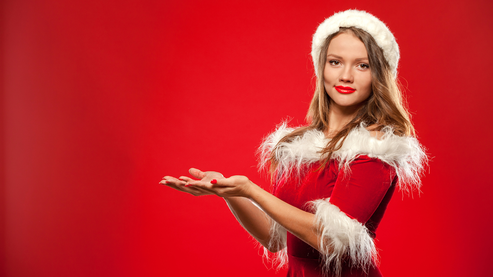 Bilder Neujahr Braune Haare Mädchens Hand Uniform Blick Roter Hintergrund 1920x1080 Braunhaarige Starren