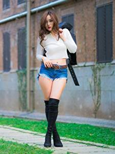 Pictures Shorts Legs Beautiful Wearing boots Blurred background Posing Brown haired young woman