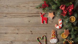 Fotos Neujahr Kekse Süßigkeiten Bretter Ast Design Schleife Lebensmittel