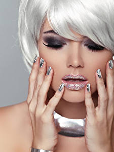 Photo Gray background Blonde girl Makeup Hands Manicure Girls