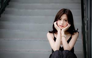 Desktop wallpapers Asian Bokeh Brunette girl Staring Hands Sitting Girls