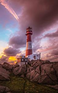 Bilder Norwegen Küste Sonnenaufgänge und Sonnenuntergänge Leuchtturm Steine Himmel Wolke Nymark Rogaland Natur