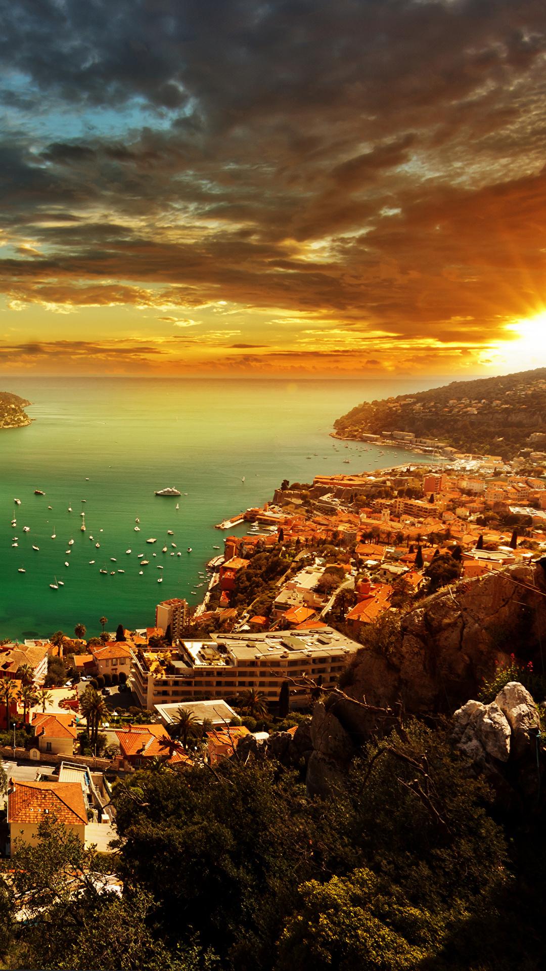 Fotos Monaco French Riviera Himmel Landschaftsfotografie Morgendämmerung und Sonnenuntergang Küste Haus Wolke Städte 1080x1920 für Handy Sonnenaufgänge und Sonnenuntergänge Gebäude