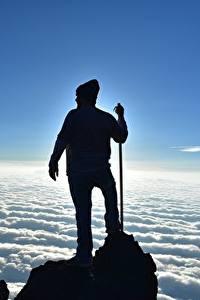 Hintergrundbilder Mann Kletterer Felsen Wolke Silhouetten