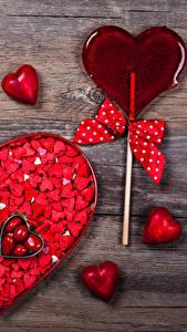 Bilder Valentinstag Viel Süßigkeiten Dauerlutscher Bretter Herz Schleife