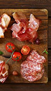 Fotos Fleischwaren Wurst Schinken Tomate Schneidebrett