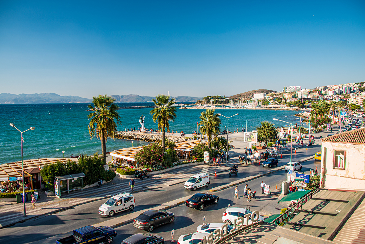 Pictures Turkey Kusadasi Sea People Street palm trees Waterfront Houses Cities Palms Building