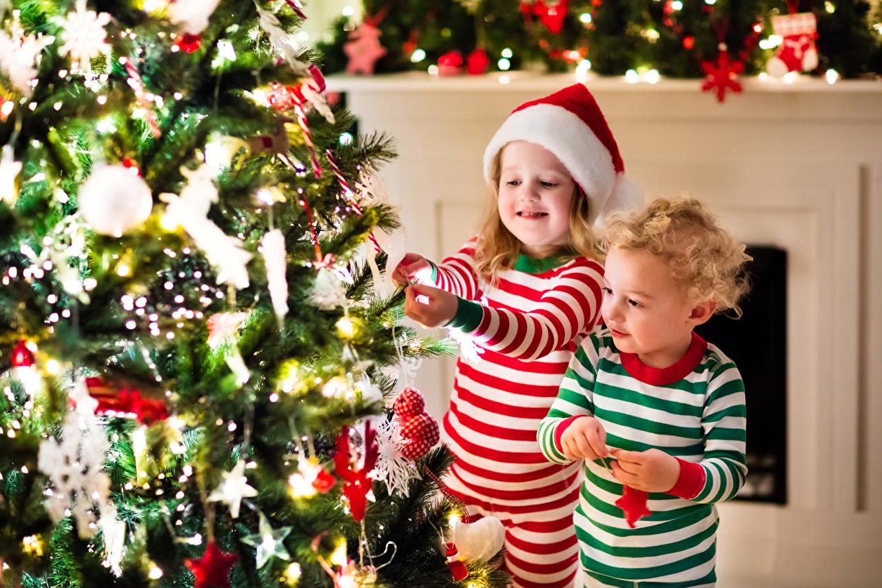 Wallpaper Little girls Boys New year child 2 Winter hat Christmas tree Holidays Christmas Children Two New Year tree