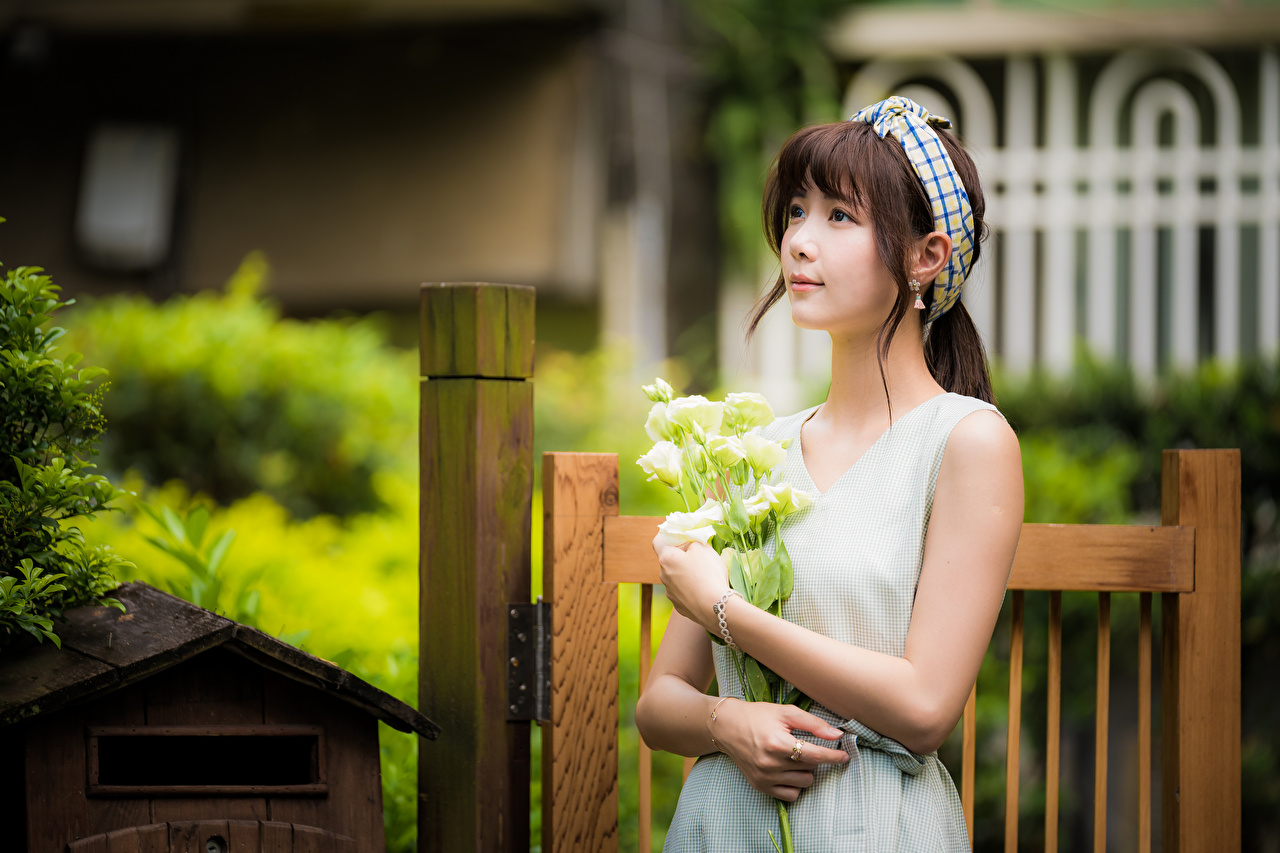 Pictures Brown haired Bokeh bouquet Girls Asian Staring gown blurred background Bouquets female young woman Asiatic Glance frock Dress
