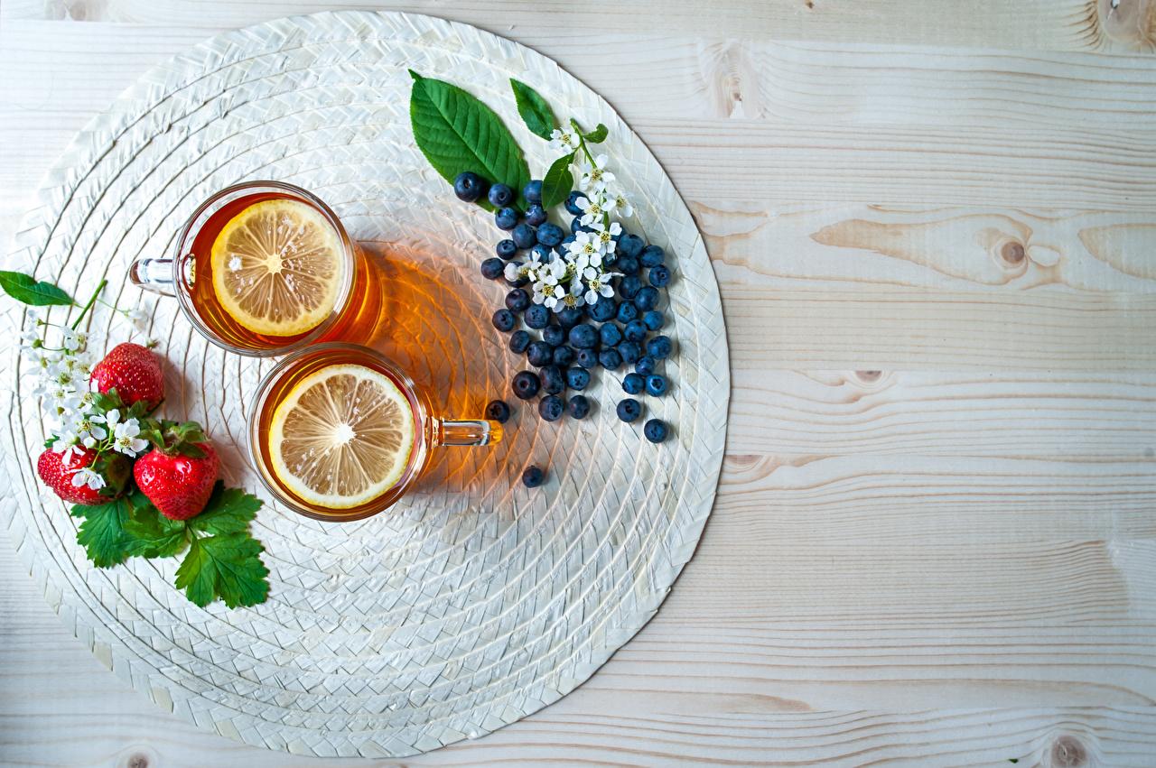 Desktop Wallpapers Tea Lemons Strawberry Blueberries Cup Food boards Wood planks
