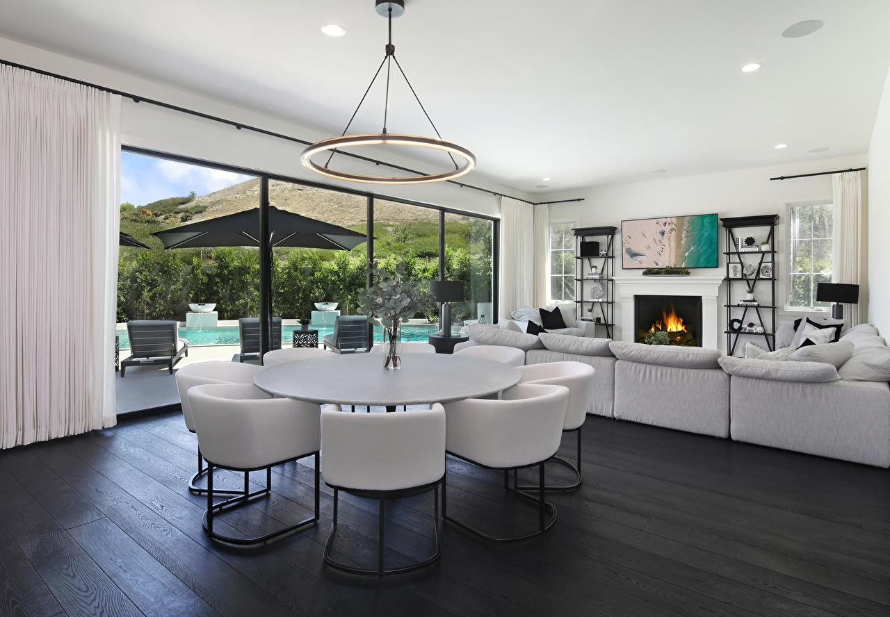 Foto Wohnzimmer Kamin Innenarchitektur Tisch Stuhl Kronleuchter Design Cheminée Lüster Stühle
