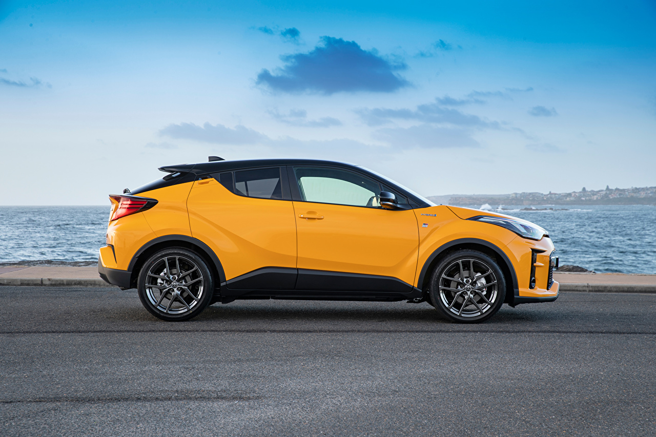 Wallpaper Toyota CUV C-HR Hybrid GR Sport, AU-spec, 2020 Hybrid vehicle Yellow Cars Side Metallic Crossover auto automobile
